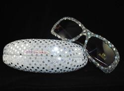 Silver clamshell case w/black sunglasses