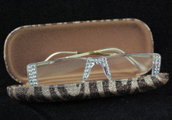 Clear crystals on Gold frames in Gold zebra case