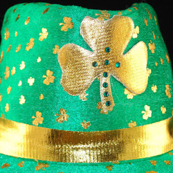 Close up view of gold lame band and Shamrock design w/crystals