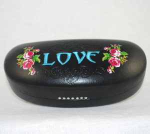 "Top of case showing ""Love"" motif"