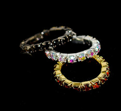 View of AB,Jet Black, and Ruby on Gold Toe Rings