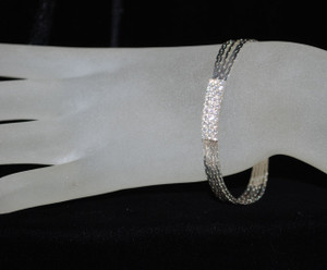 Front view w/ crystals on hand model