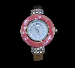 Full face view of pink bangle watch
