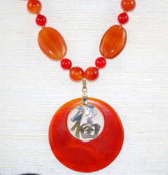 Close up view of 12kt Carnelian pendant (and other beads)