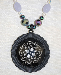Enlarged detail of matte/faceted glass pendant