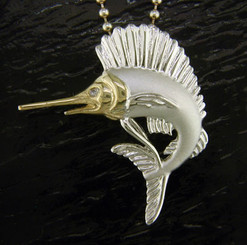Steven Douglas Sterling silver and 14k gold Sail Fish