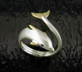 SS AND 14K SM. DOLPHIN RING WITH BLUE SAPPHIRE EYES WRAP RING: ADJUSTABLE TO SIZES 5-7 SIZE: 11/16in. /19mm Wide