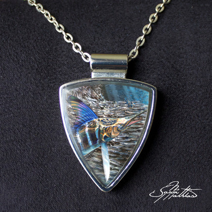 """necklace-pendant-striped-marlin-jason-mathias-jewelry.jpg  Jason Mathias fine art jewelry: This beautiful chrome plated pendant features """"Striped Gem"""" by world renowned artist Jason Mathias. Artwork will not fade and is carefully set within a fine quality resin for a brilliant finish that will capture the light and the attention of your friends and family.   Chain included."""