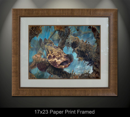 """Golden Goliath"" skilled artist Jason Mathias masterfully portrays a hulking Jewfish or Goliath Grouper standing guard over an old structure. This item features ""Golden Goliath"" in a mini framed giclee paper print. Print size is ""17x23"", frame size is ""29.5x35.5"". Beautifully framed with a nice honey color wood finish and professionally doubble matted for that high end museum quality fine art look."
