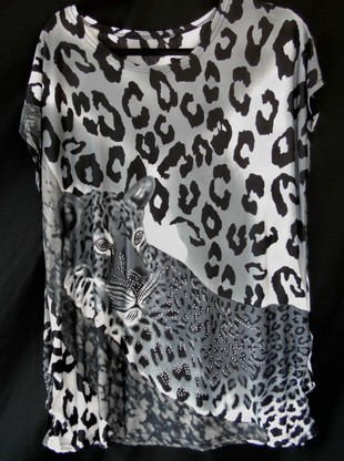 Short Sleeve Animal Print in a combination of Black & Greys with Rhinestones.  Fabric is 95% Polyester & 5% Spandex.  One size fits most, S-XL.  The dots you see in photo are the Rhinestones.