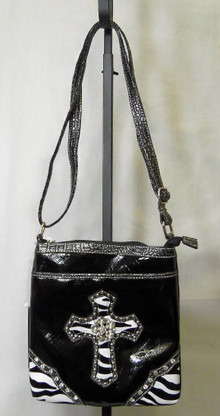 Beautiful black purse with zebra accenting and a shoulder strap