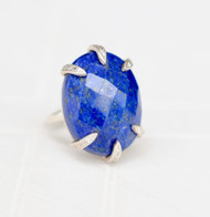 Oval lapis statement ring with pave white topaz prong setting