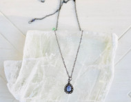 Iolite and diamond drop necklace on a oxidized chain