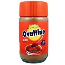 Ovaltine Drink Mix 14oz in a glass bottle with Orange labeling