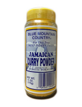 Blue Mountain Curry Powder in a plastic bottle with Blue and Yellow labeling