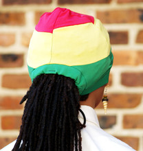 Knit fabrics in the traditional Jamaican colors create the perfect ponytail cap for locs or braids.