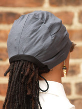 Knit fabric.  Fits like a cap but stays on your head even while sleeping.  If you have been seeking a cap that stays on your head even when you sleep, your quest is over. The Stay On Pony Cap is the hat for you. It's unique secure tie feature, also puts your hair in a ponytail. If you are thinking, that is amazing..you should know it's also comfortable too. To easily use, just place the cap on your head with the elastic going across the front of the head as usual. Then bring the draw strings to the kitchen areas of your hair in the back to create a ponytail. After this, just tie it off based on what feels comfortable for you.