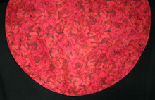 "25"" in diameter red rose table runner with self fabric bias edging.  Light weight cotton fabric with red cotton backing."