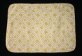 "17"" X 12"" Gold with white diamond design placemat. Self fabric bias edging.  Medium weight fabric with a white medium weight fabric backing.  Washable in cold water."