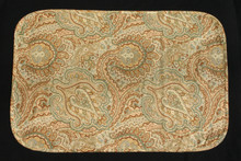 "20"" X 13"" Green, tan, brown & blue paisley placemat.  Self fabric bias edging.  Light weight fabric with a light weight green fabric backing."