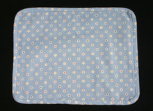 """15"""" X 12"""" Blue with white and colored flowers placemat. Self fabric biased edging.  Medium weight fabric with light weight navy blue fabric backing.  Washable in cold water."""