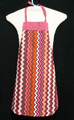 "Pink, brown, rust & white verticle zig zag striped apron with pink trim and straps to fit a child sized 3-5.    Made of woven cotton for easy cleaning  The apron without straps is 21"" long.  The waist is adjustable from 14"" to 24""."
