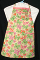 "Yellow background with green, pink and orange butterflies, hearts and flowers child's apron with adjustable strap allowing easy adjustment for fitting a child sized 10-13.  The apron grows with the child!  The apron has pink binding across the top and on top of each of the three pockets.  The apron without straps is 24"" long.  The waist is adjustable from 22"" to 34""."