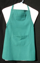 """Green child's apron with adjustable strap, allowing easy adjustment for fitting a child sized 10-13.  The apron grows with the child!  The apron has two pockets. Made of woven medium weight cotton for easy cleaning.  The apron without straps is 24"""" long.  The waist is adjustable from 22"""" to 28""""."""