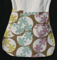 "Blue, pink and yellow flower child's waist apron in size 10-13, with two pockets.  Made of medium weight woven cotton for easy cleaning.  Fits waist 20"" to 26""."