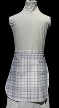 """Lavender and white plaid child's waist apron in size 6-10, with two pockets.  Made of medium weight woven cotton for easy cleaning.  Fits waist 16"""" to 22""""."""