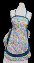 "Blue, pink, yellow with green leaves, on white floral background, size small adult apron, with blue trim edging and ruffled skirt.  The apron ties around the neck and waistline.  Made of light weight cotton for easy laundering.  Apron without the ties is 26"" long.  Fits waists 22"" to 30""."
