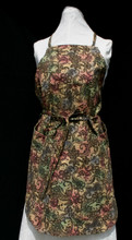 "Black paisley on shades of yellow, blue, green and pink adult work apron with ties for neckline and waist.  The apron has four pockets, one at the bust line, one below waist line, with stitched separations to create 4 sections that are 10 1/2"" to 12 1/2"" long and 2 pockets on each side of the apron below the waist line.  Made of medium weight cotton for easy laundering.  Apron, not including ties, is 30"" long.  Fits waists 26"" to 42""."