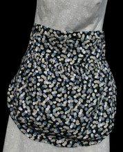 "Black with tan and 2 shades of grey circles, clothes pin apron.  Apron is a waist apron with a large pocket to carry clothes pins.  GO GREEN!  You would no longer need to run back and forth to the clothes pin bag when hanging your laundry out to dry after washing.  Pocket has an elastic top to keep clothes pins from falling out.  Made of cotton for easy laundering.  Fits waists 28"" to 52""."