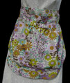 "Lavender, brown and green flowers on white background clothes pin apron.  Apron is a waist apron with a large pocket to carry clothes pins.  GO GREEN!  You would no longer need to run back and forth to the clothes pin bag when hanging your laundry out to dry after washing.  Pocket has an elastic top to keep clothes pins from falling out.  Made of cotton for easy laundering.  Fits waists 28"" to 52""."