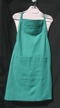"""Green adult apron, sized for a man, but a woman can wear it too!  The apron has an adjustable strap for easy fitting of many sizes of people.  It has two pockets.  One pocket at bust level and the other below the waistline with stitching giving the pocket two sections.  Made of cotton for easy laundering.  The apron without the strap is 33"""" long.  Fits waists 34"""" to 46""""."""