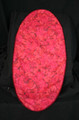 """12 1/2"""" X 27"""" Red rose print fabric oval table runner with a red braided cord edging for the center of a table.  Cotton woven fabric with a red satin backing."""