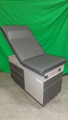 RITTER 104 GYN EXAM TABLE WITH NEW UPHOLSTERY IN CHARCOAL GRAY