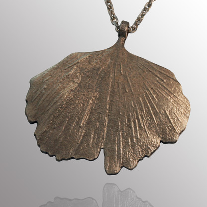 Silver gingko leaf pendant with 22in. adjustable chain.  17X25mm.
