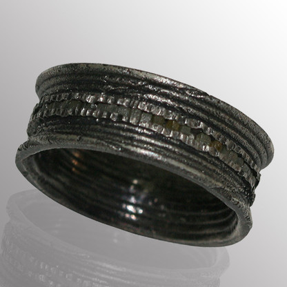 Silver ring with 0.7ct. raw diamonds.  8mm wide.