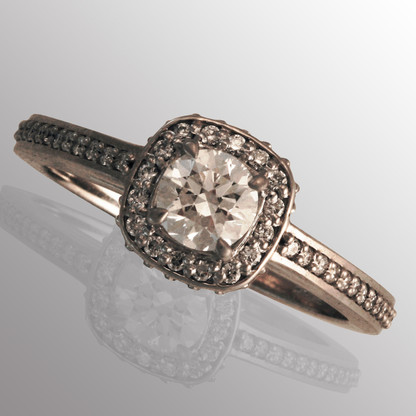 4K white gold engagement ring with 1ct. center diamond and 1/5ct. side diamonds