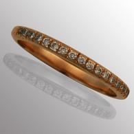 18K rose gold wedding band with 1/5ct. diamond.  2.1mm wide