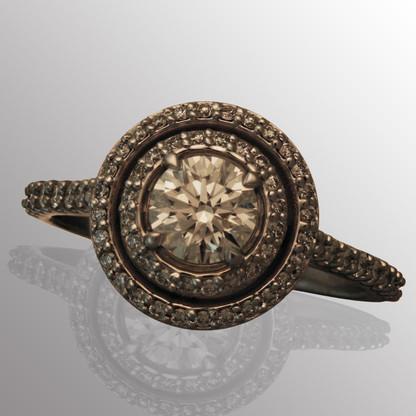 Platinum engagement ring with 72pt. center diamond and 40pt. side diamonds.