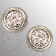 Platinum stud earrings with 40pt. diamond.  5.7mm wide.