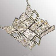 21K yellow gold and sterling silver pendant with 0.3ct. raw diamonds.