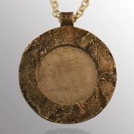 18K yellow gold and sterling silver pendant with meteorites.  21mm wide.