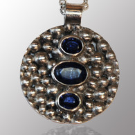 Sterling silver bubble pendant with 2ct. sapphire.  33mm wide.