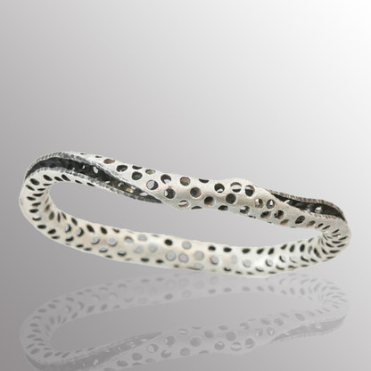 Silver twist bangle with blackener on the inside.  12.7mm wide.