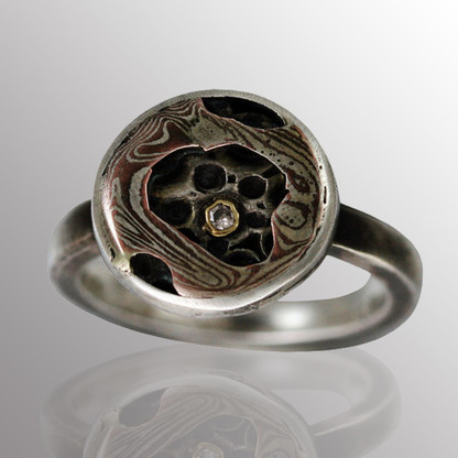 Sterling silver ring with 18K yellow gold and Mokume Gane (silver and copper), and 3pt. diamond.