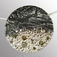 Sterling silver and blackened silver pendant with 0.15ct. raw diamond.  33mm wide.