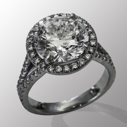 Platinum engagement ring with 3.92ct. center diamond and 1/2ct. all side diamonds.
